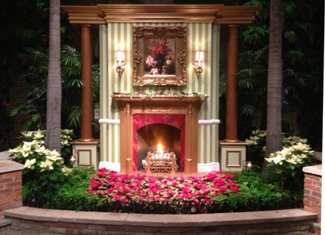 A warming holiday hearth welcoming visitors in the first room, the Palm Court